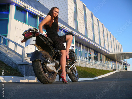 Beautiful girl on a motorcycle.