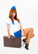 Pretty stewardess on suitcase
