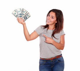 Charming young woman holding cash dollars