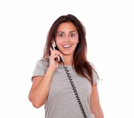 Surprised gorgeous young woman talking on phone