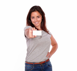 Charming young woman holding her business card