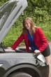 Female motorist with the car bonnet up