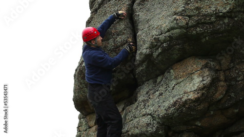 Man climbing up a steep rock.