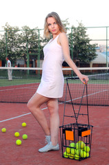 Pretty sportswoman at the tennis court