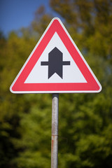 Triangular traffic sign for a crossroads