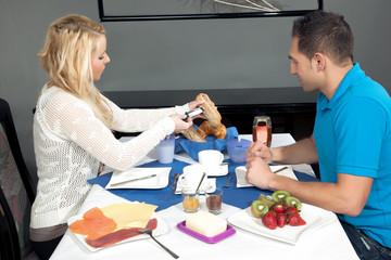 Young couple enjoying a hotel breakfast