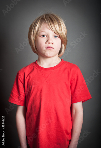 Upset child with a sad face
