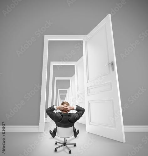 businnessman and openet doors