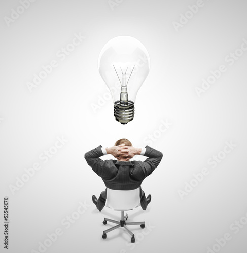 man drawing lamp over head