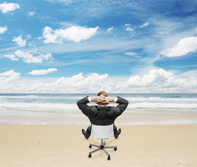 businnessman sitting on beach