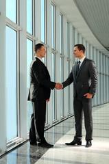 two young businessman handshake