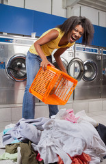 Woman Screaming While Holding Basket With Clothes On Floor