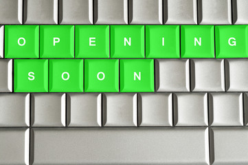 Opening Soon spelled on a metallic keyboard