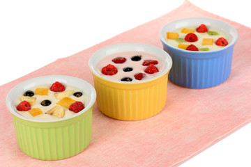 Delicious yogurt with fruit isolated on white