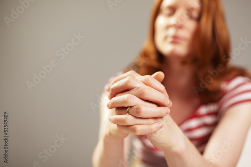 A female believer praying with faith