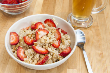 Warm millet pudding with Strawberries