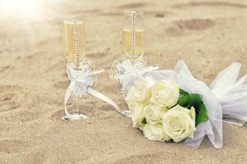 Wedding glasses on sand