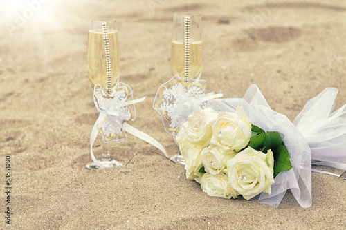 Wedding glasses on sand