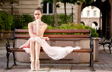 Young beautiful ballerina posing outdoor