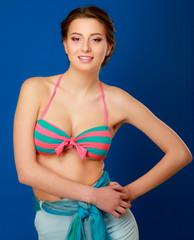 woman in bikini isolated on blue background