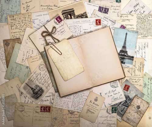Obraz w ramie old postcards and open book. nostalgic vintage background