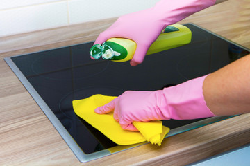 female hands in rubber gloves cleaning