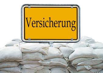 Sandsäcke und Schild - Versicherung