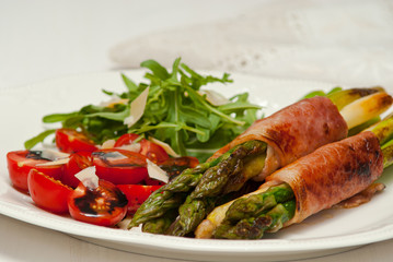 Asparagus grilled with ham, and fresh cherry tomato salad