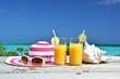 Sunglasses, hat and orange juice