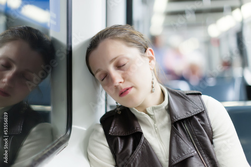 Sleeping girl sitting in train