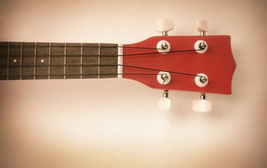 Part of red ukulele