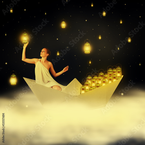 Young sexy woman goddes in night sky