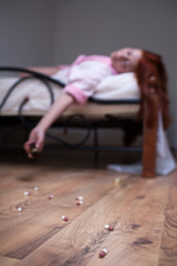 woman in bed  overdose tablet