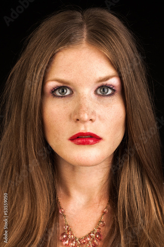 Portrait of young beautiful redhead freckled girl