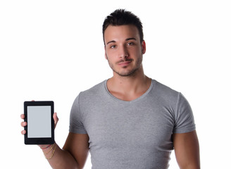 Attractive young man holding and showing ebook reader