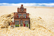 House disappearing in the sand.