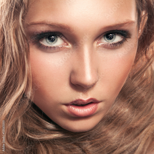 Young woman looking at camera in studio