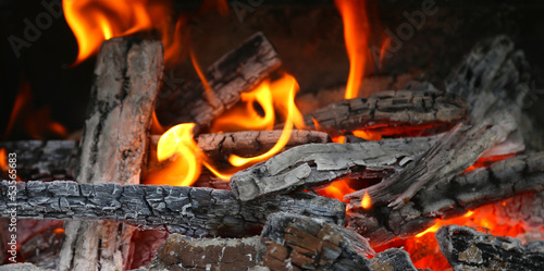 fireplace with coals burning down
