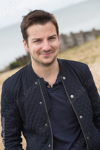 Handsome young man at the seaside