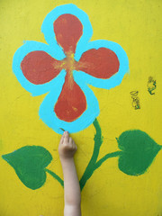child's hand with flower