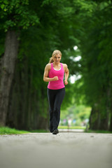 Active young woman jogging in the park