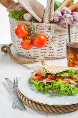 Kebab in pita bread next to vegetable basket