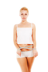 Young beautiful woman with measure tape