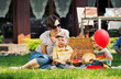 Photo presenting happy family in the garden