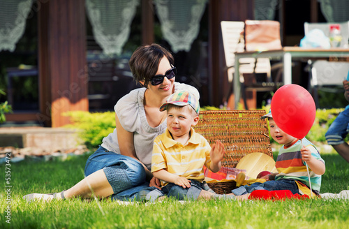 Photo presenting happy family in the garden