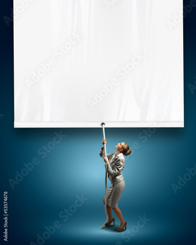 Businesswoman pulling blank banner