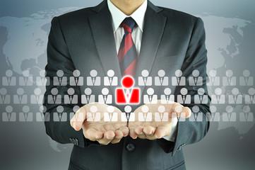 Businessman holding human icon - HR, HRM concept