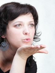 woman blowing a kiss woman isolated