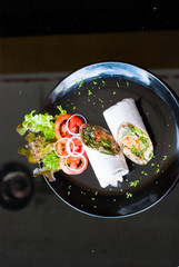 Salmon wrap with roti dough top view