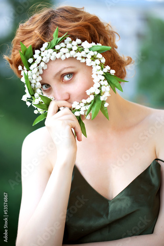 Portrait of a beautiful redhaired curly female model